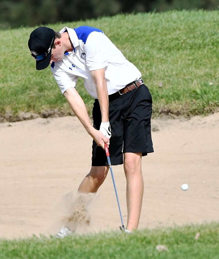 Lake Zurich's Alec Rosenbaum hits from the bunker at the North Suburban Conference boys golf tournament at Willow Glen Golf Club in North Chicago Tuesday.