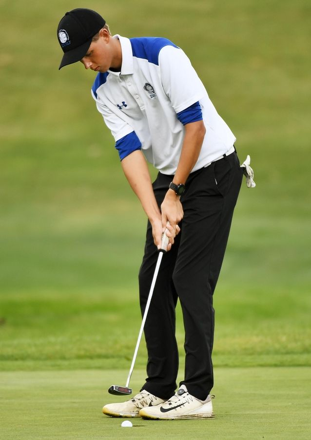 Lake Zurich's Jaso Czabaj watches his putt fall at the North Suburban Conference boys golf tournament at Willow Glen Golf Club in North Chicago Tuesday.