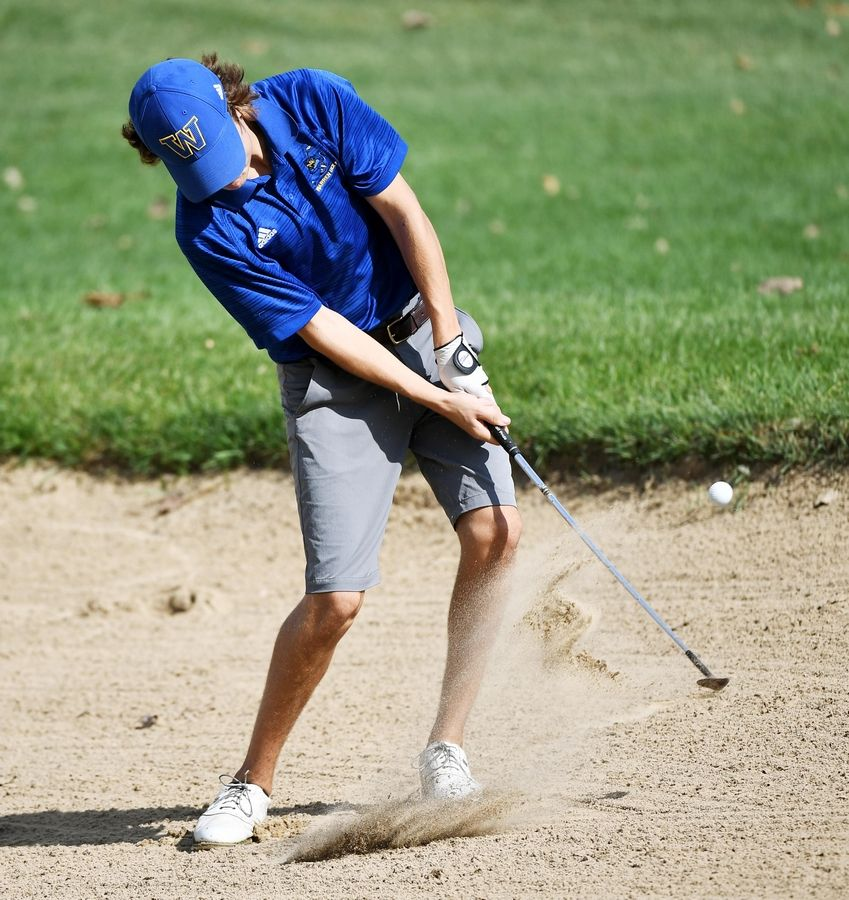 Warren's Steffen Nerheim hits from the bunker at the North Suburban Conference boys golf tournament at Willow Glen Golf Club in North Chicago Tuesday.