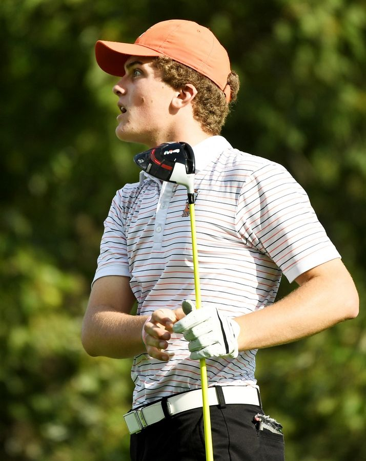 Libertyville's Derek Calamari watches his tee shot at the North Suburban Conference boys golf tournament at Willow Glen Golf Club in North Chicago Tuesday.