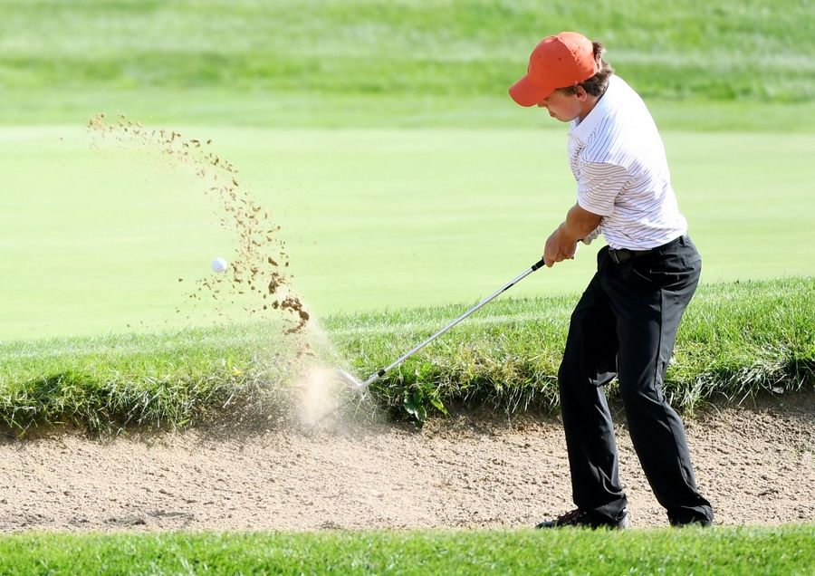 Libertyville's Carson Darnall hits from the sand at the North Suburban Conference boys golf tournament at Willow Glen Golf Club in North Chicago Tuesday.