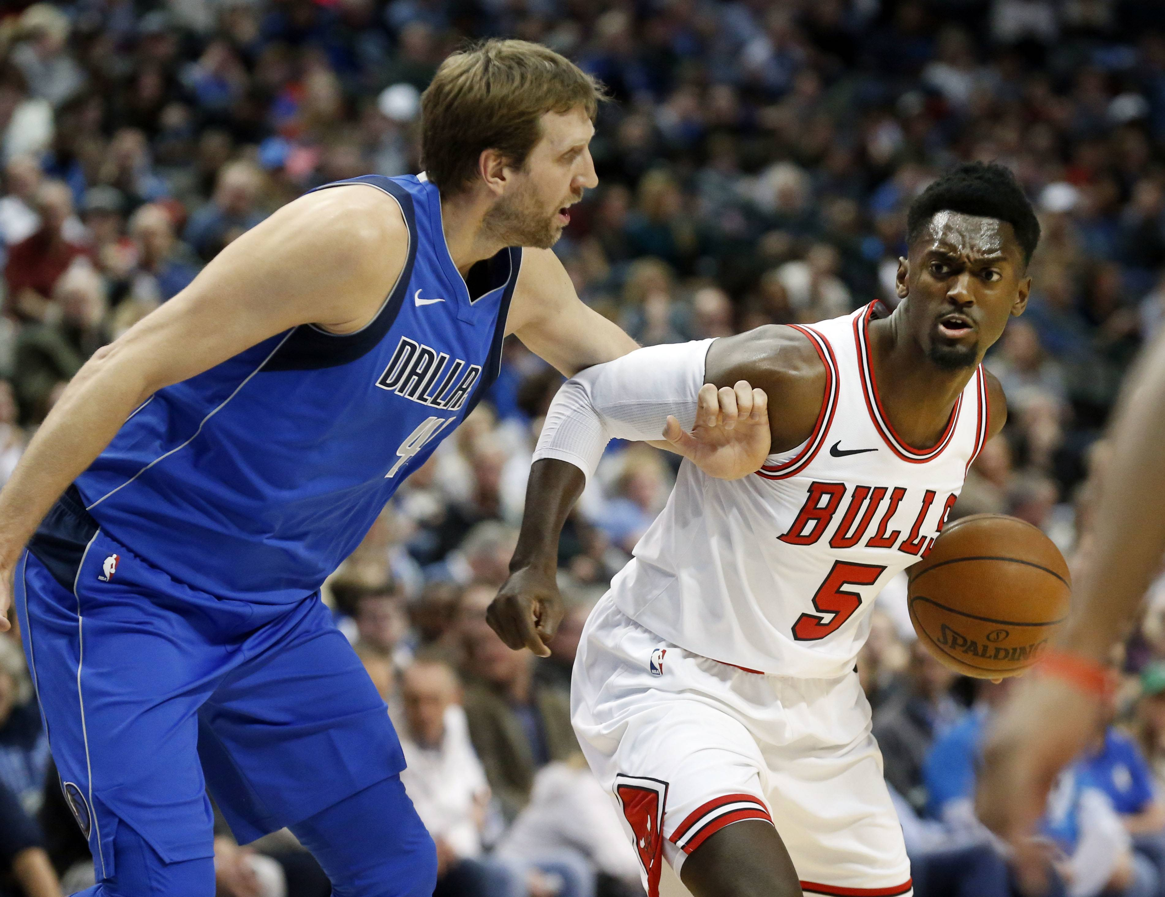 Bobby Portis, here moving on Dallas's Dirk Nowitzki last season, said not being in the starting five suits him well.