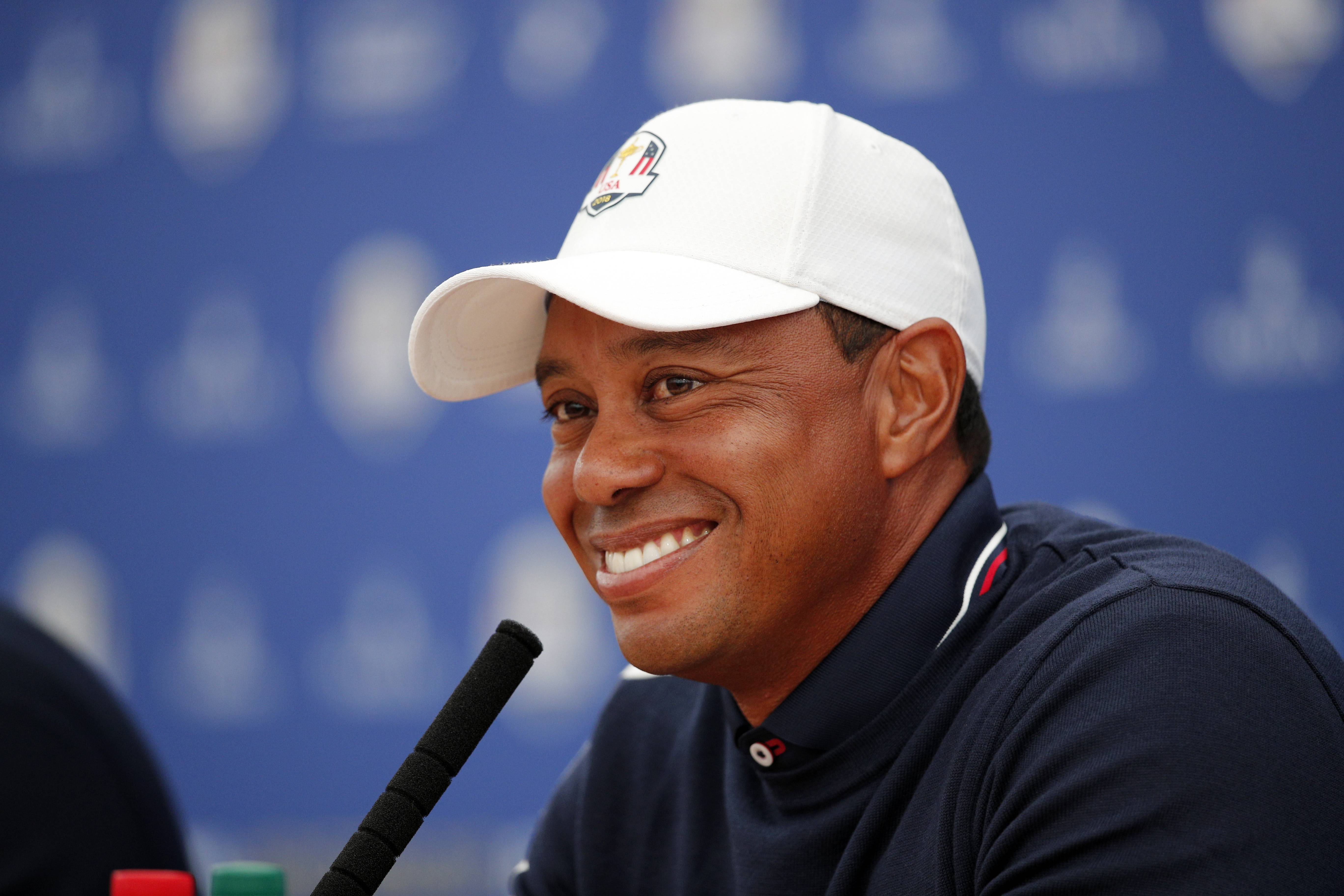 Tiger Woods of the US answers questions during a press conference as part of the 2018 Ryder Cup at Le Golf National in Saint-Quentin-en-Yvelines, outside Paris, France, Tuesday, Sept. 25, 2018. The 42nd Ryder Cup will be held in France from Sept. 28-30, 2018 at Le Golf National. (AP Photo/Francois Mori)