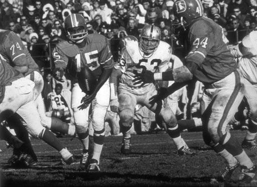 In this undated handout from the Denver Broncos, Marlin Briscoe completes the option to Floyd Little. Fifty years ago, Marlin Briscoe became the first black quarterback to play in the American Football League. He started five games for the Denver Broncos and was runner-up for AP's AFL Rookie of the Year award in 1968. The Pro Football Hall of Fame calls the Omaha, Neb. native the first black quarterback in the modern era of pro football. (Denver Broncos via AP)