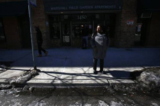 "In this Tuesday, March 5, 2015, photo, Precious Murphy stands outside Marshall Field Garden Apartments, one of the last larger-scale buildings with subsidized housing in a neighborhood that was once home to the Cabrini-Green housing project in Chicago. Despite her interest in Art on Sedgwick and friendship with its founder, Charlie Branda, Murphy and her four children moved to Bloomington, Indiana, to start a new life. Murphy said she couldn't wait to move from a set of buildings that are often the target of resentment in a gentrifying neighborhood. That said, she regularly returns to visit Branda and is ""very proud"" of the work happening at the art studio."