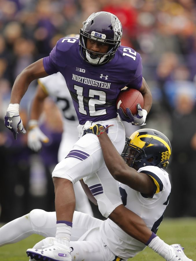 Northwestern's JJ Jefferson, left, is grabbed by Michigan's David Long during the first half of an NCAA college football game Saturday, Sept. 29, 2018, in Evanston, Ill.