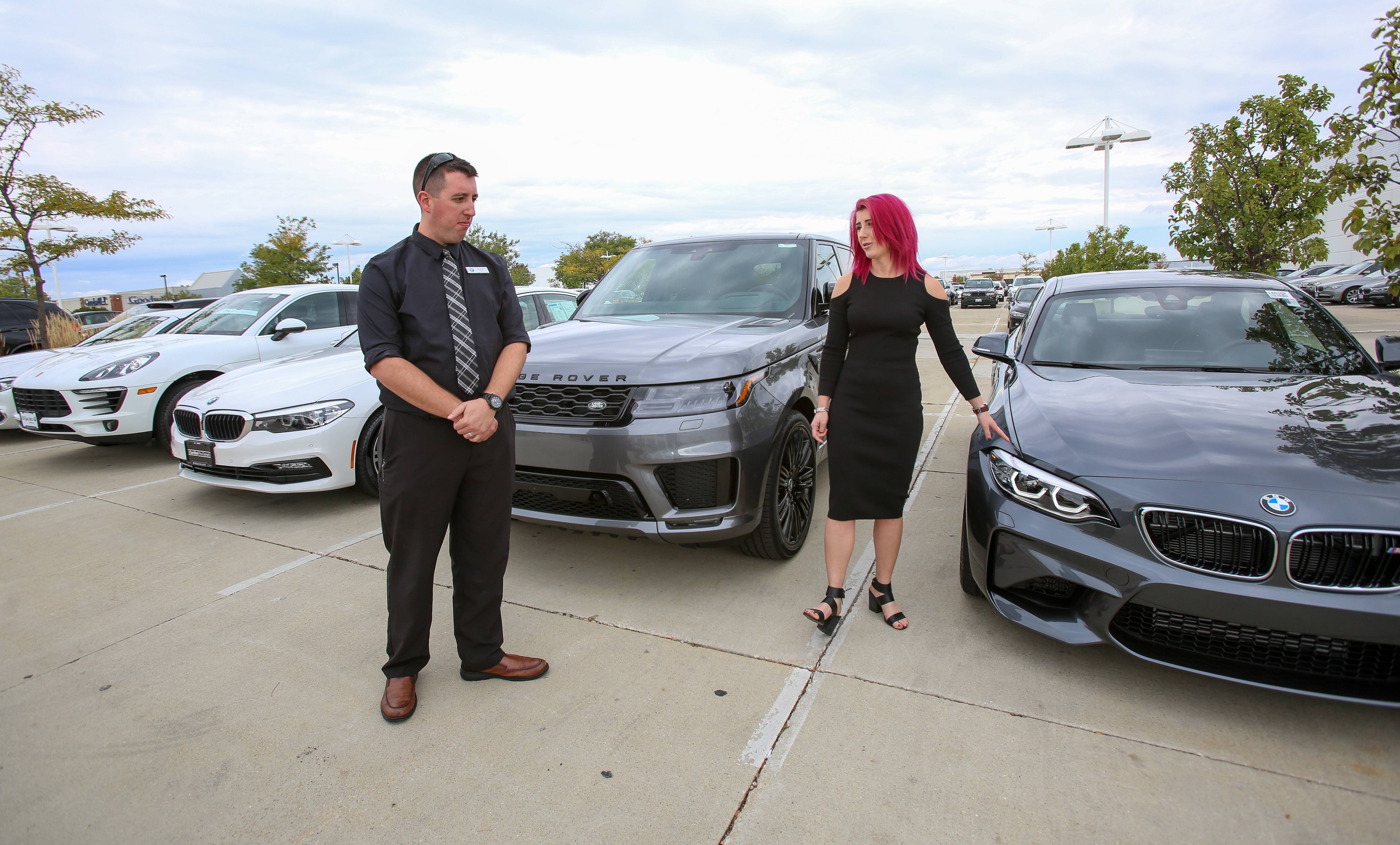 Nic Cortellini, a concierge in the new Shift by Bill Jacobs subscription program, reviews some of the vehicles in the subscription fleet with Leigh Martino, operations manager for the program.