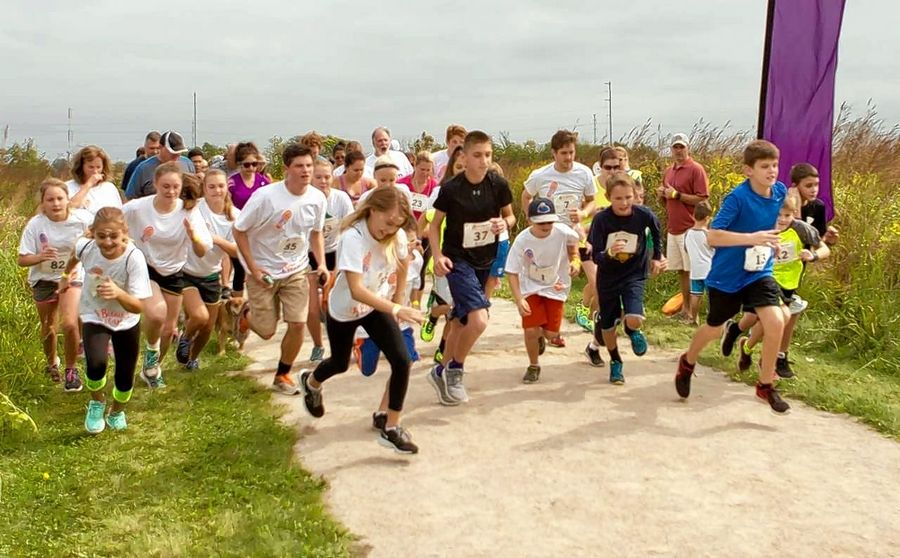 Through Fall 5K Run/Walks in Bartlett, Sycamore Trails School sixth-grader Aidan Hennessy has helped raise nearly $100,000 for Play for Peace.