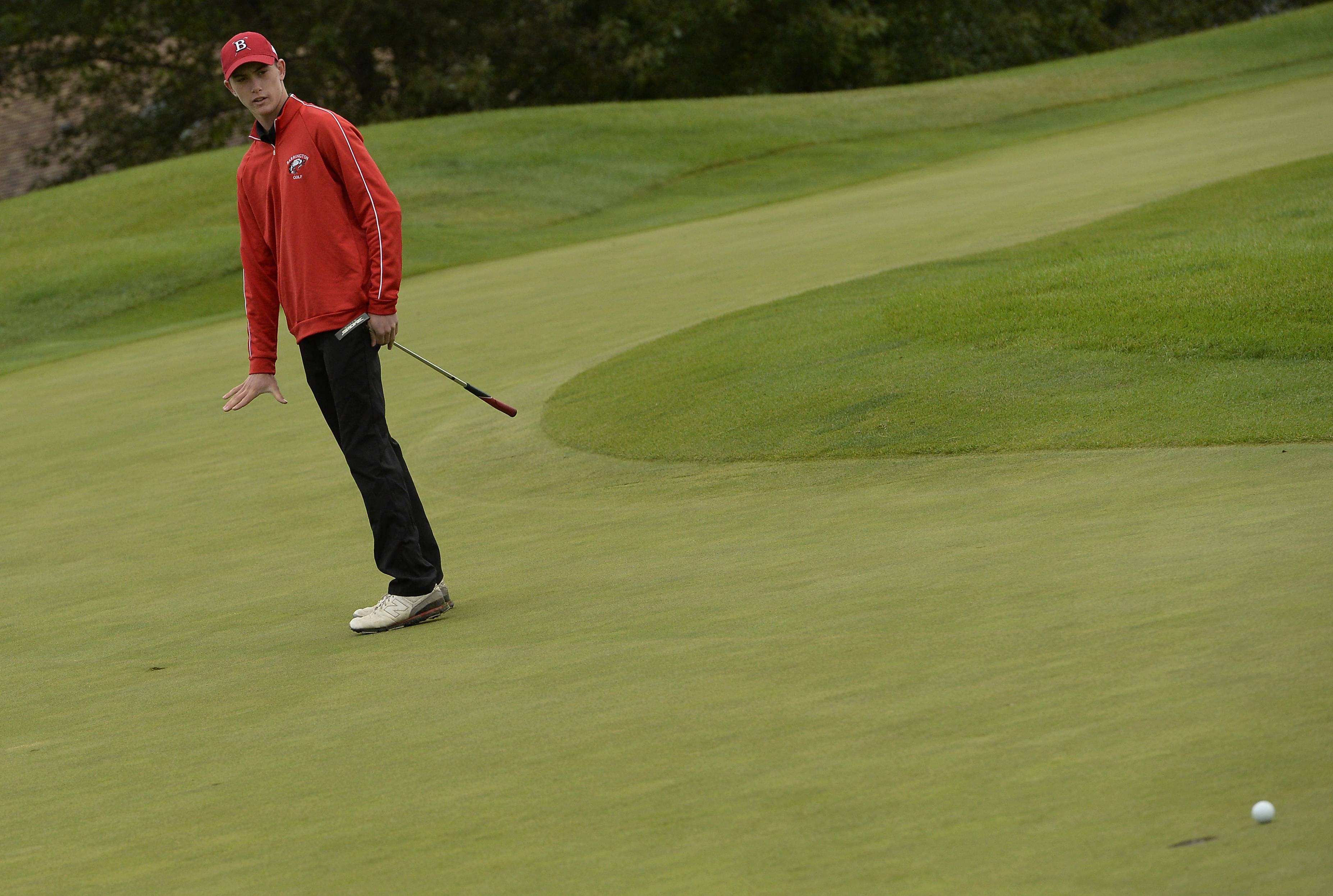 Barrington's Sean Markham gestures as he wants his ball to settle on the green after his putt on No. 1 in the boys golf regional at Makray Memorial Golf Club in Barrington on Tuesday.