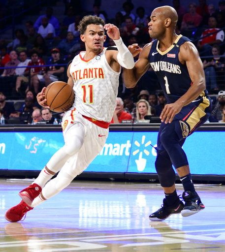 1cdf28c5f8f Atlanta Hawks rookie guard Trae Young (11) drives the lane with New Orleans  Pelicans