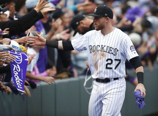 74068570f Colorado Rockies shortstop Trevor Story is congratulated by fans after the  ninth inning of a baseball
