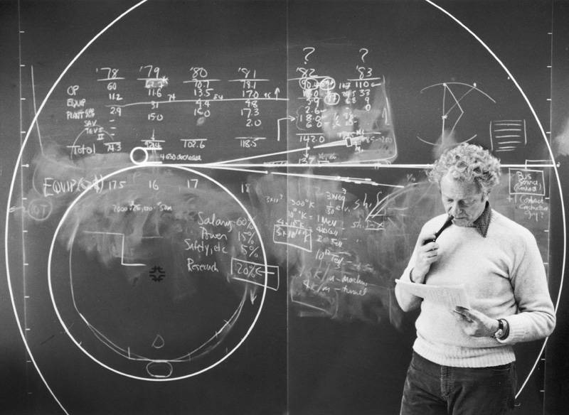 Director Leon Lederman works on the blackboard one of Fermilab's beamlines and reviews the budget in February 1983.