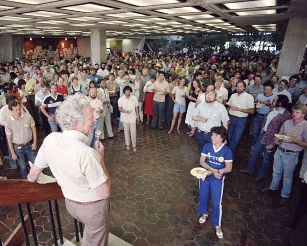 Leon Lederman leads a party celebrating Fermilab accelerator reaching a power equivalent to 512 GeV, or giga-electronvolts, in July 1983.