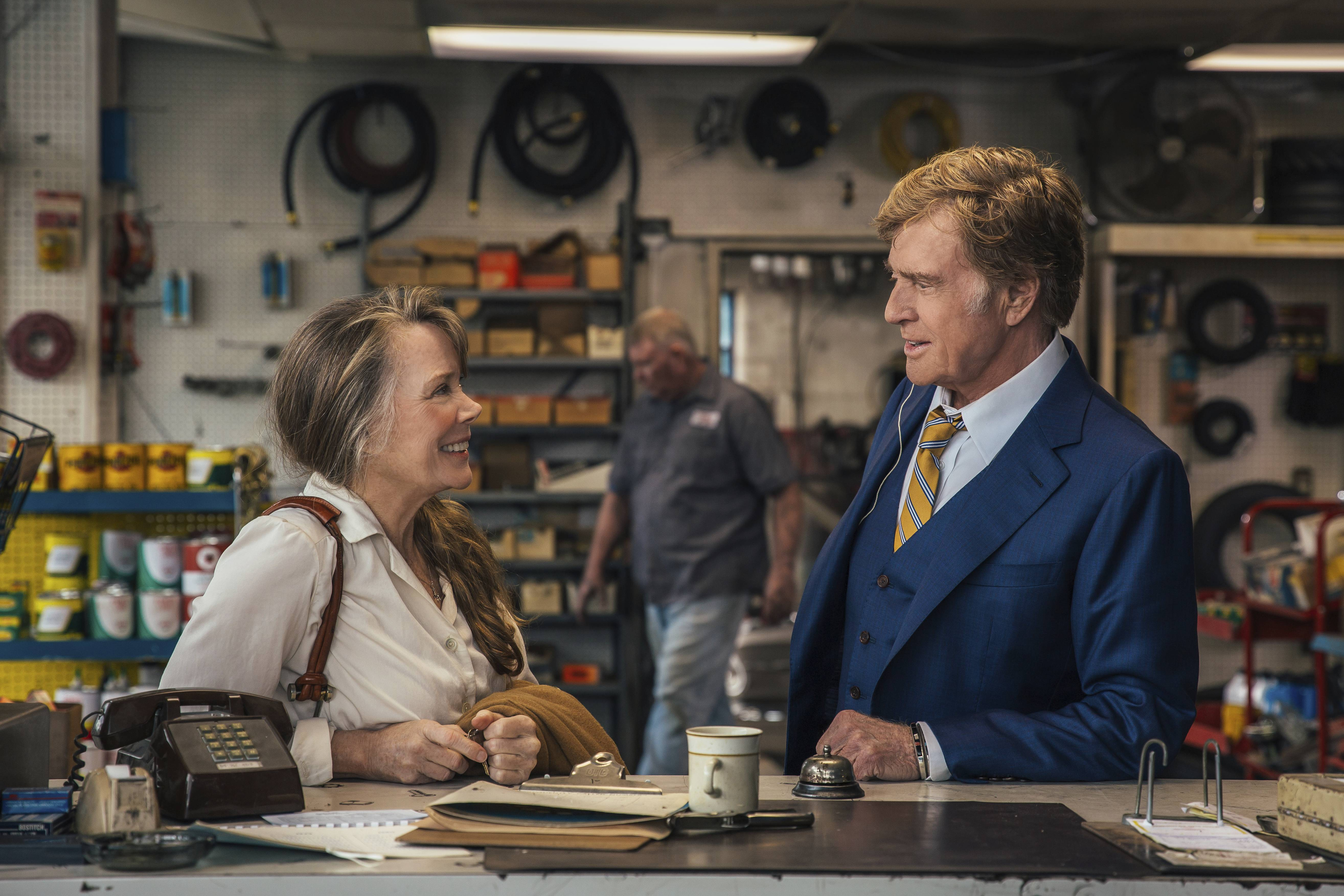 movie review robert redford charms as dapper bank robber