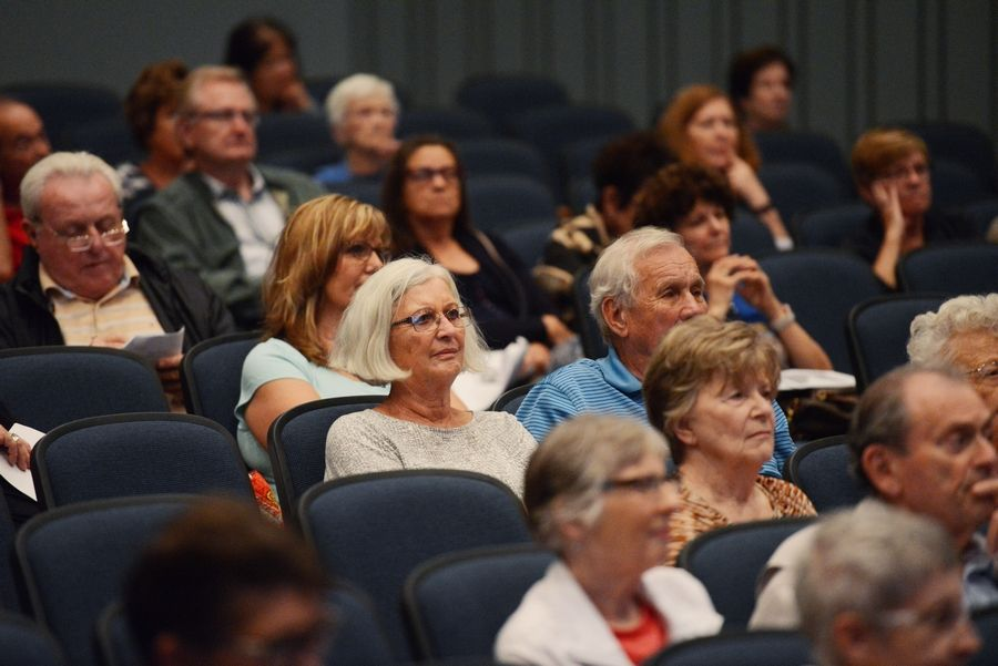 Audience members listen during a Wednesday night presentation in Arlington Heights about how to spot fake news.