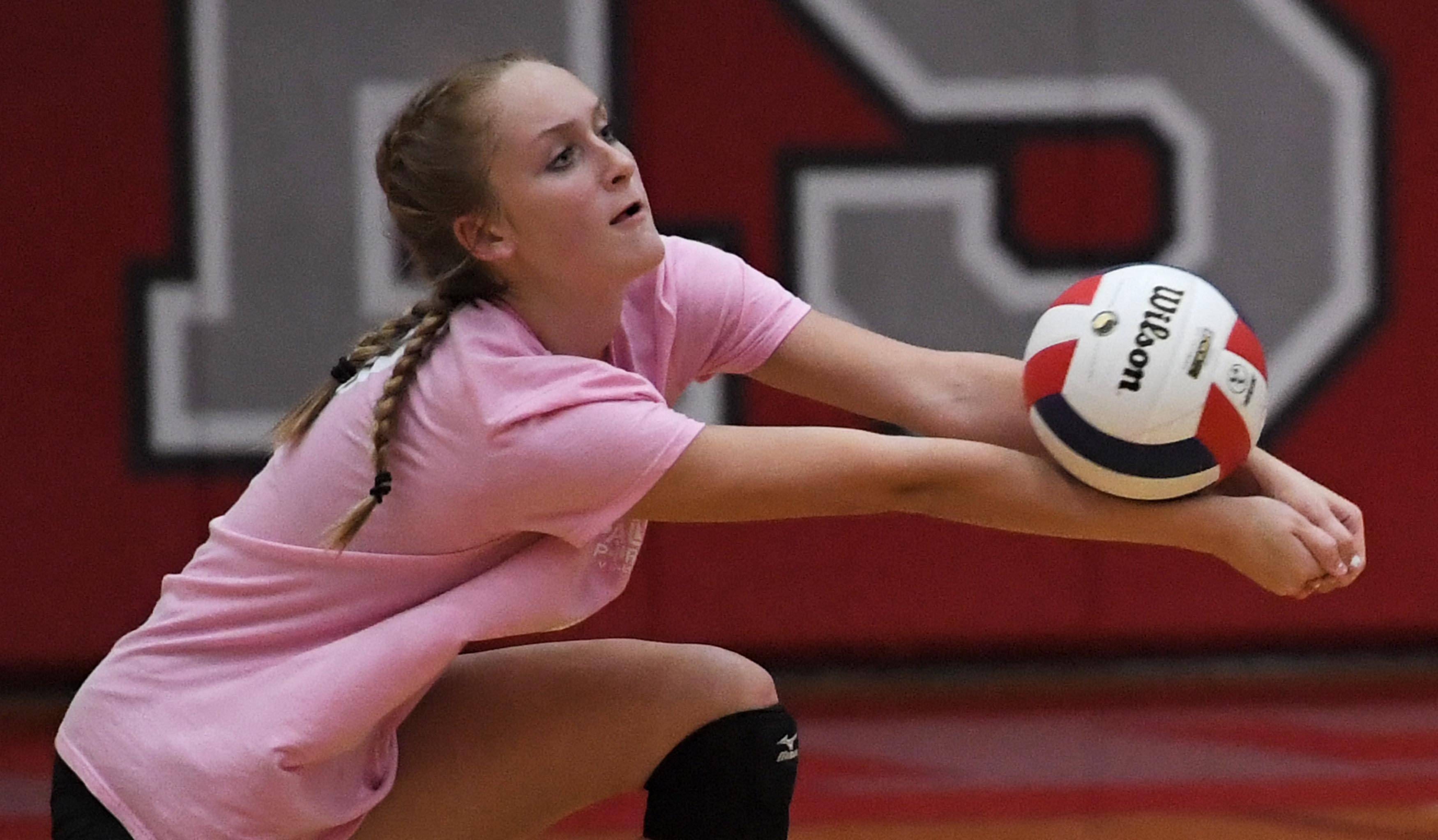 Palatine's Jillian Smith reaches for a shot by Fremd Thursday in a girls volleyball match at Palatine High School.