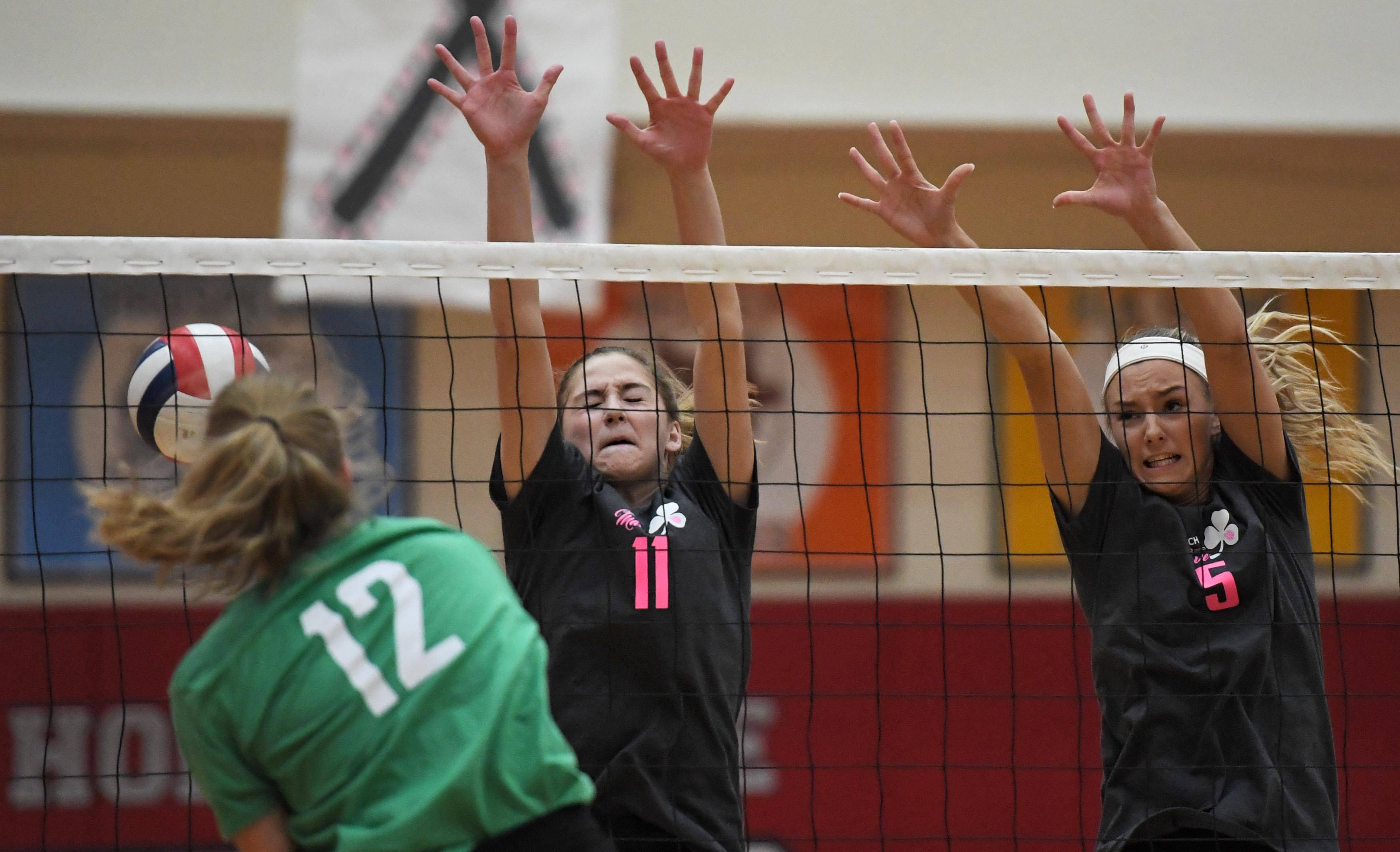 Fremd's Heidi Sayre sends her shot past Palatine's Sydney Wiebe and Karina Szfraniec Thursday in a girls volleyball match at Palatine High School.