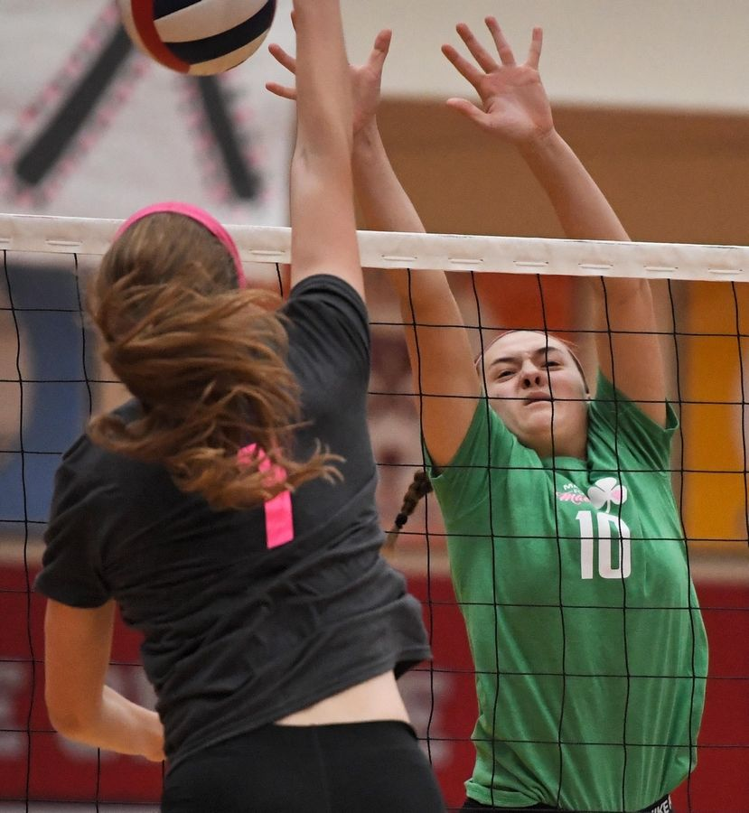 Palatine's Haley Holz sends the ball right of Fremd's Peytom Hooker Thursday in a girls volleyball match at Palatine High School.