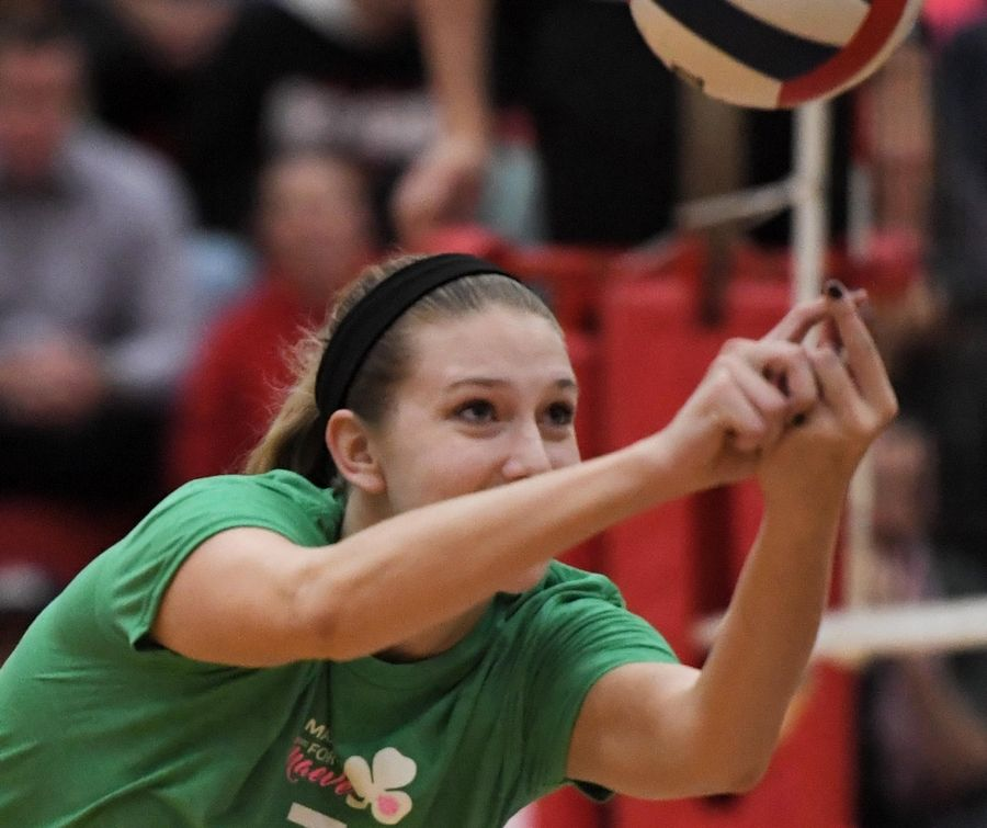 Fremd's Jules Tangney reaches for a shot against Palatine Thursday in a girls volleyball match at Palatine High School.
