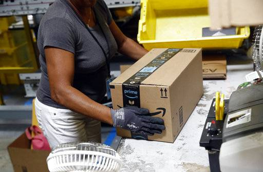 Amazon's $15 an hour a win? Not so, some veteran workers say