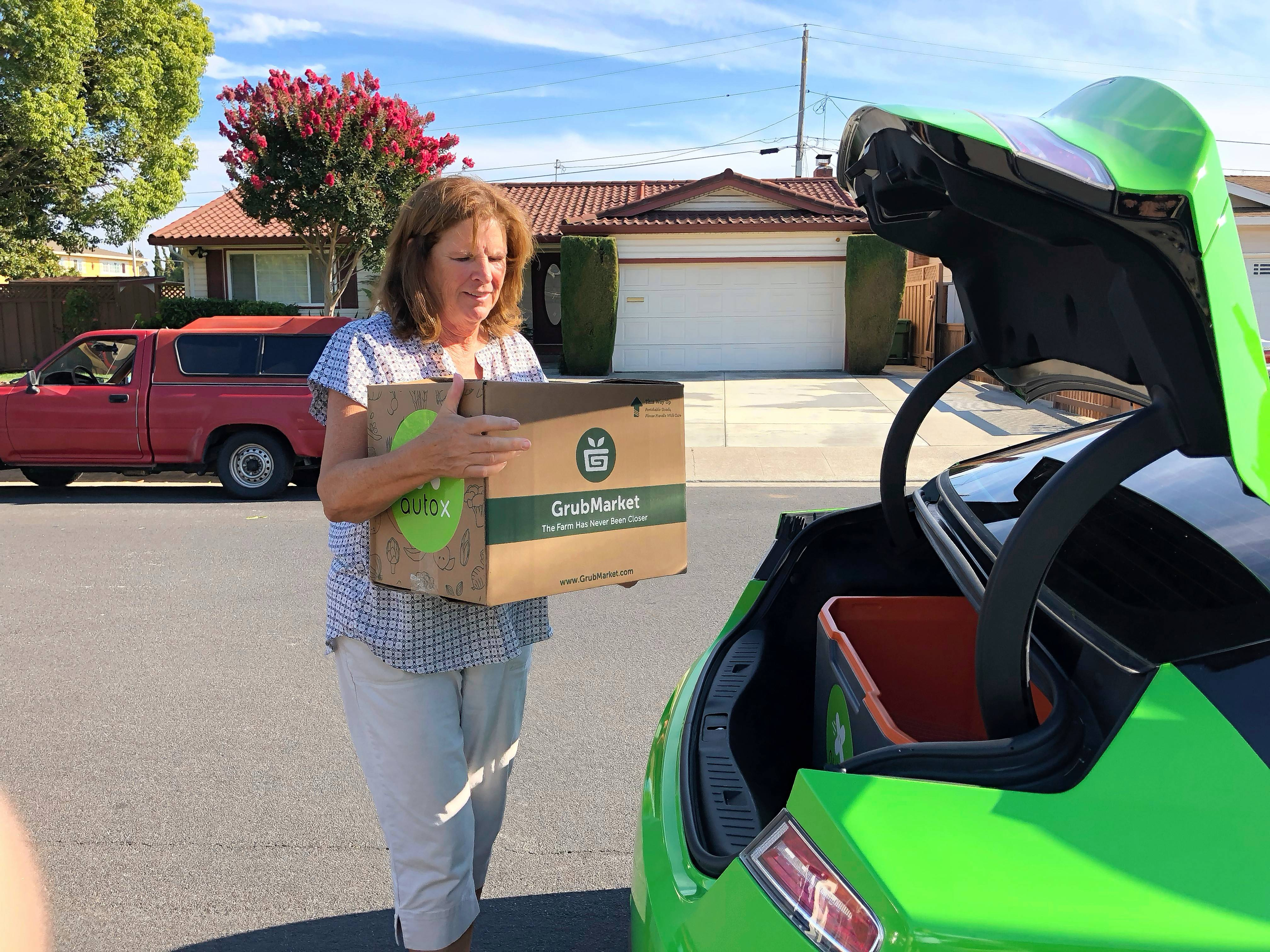 Blaskovich signed up to receive groceries from startup GrubMarket, which utilizes self-driving cars. An automated system will charge her for the add-on delivery later.