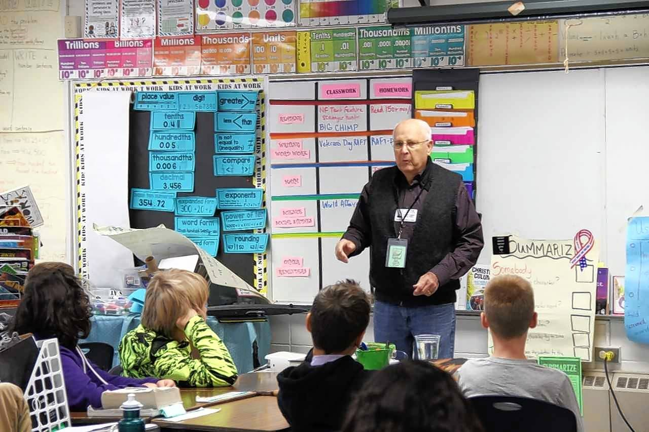 "Don Eageny of Elgin was among veterans who spoke in November at Clinton Elementary School in South Elgin as part of the ""Veterans Voices"" program. More volunteers are needed this year."
