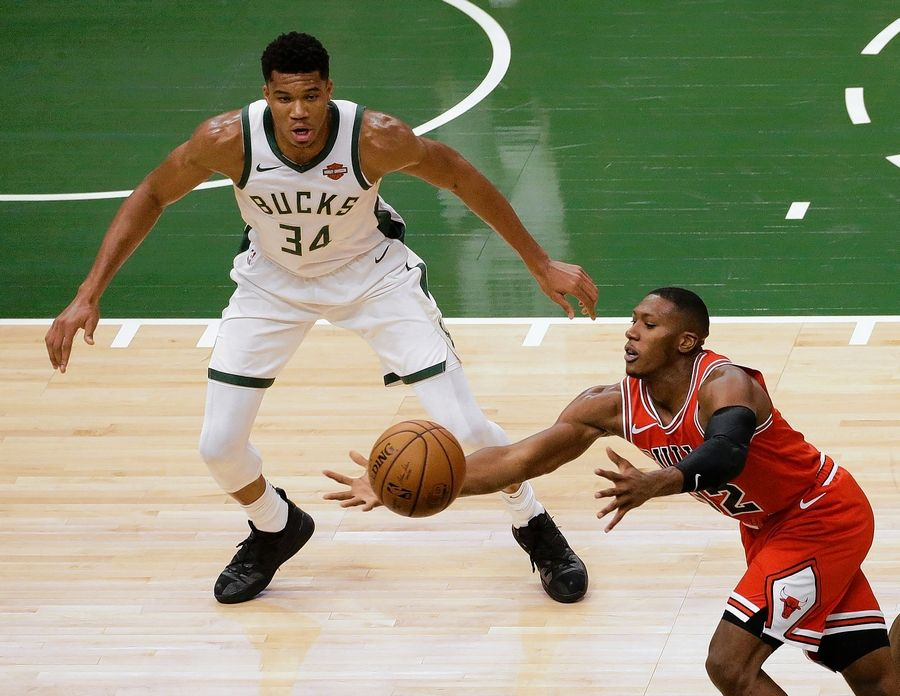 "The Bulls' Kris Dunn attempts to gain possession of the ball in front of the Bucks' Giannis Antetokounmpo during a preseason game Wednesday in Milwaukee. Coach Fred Hoiberg praised Dunn Friday, saying ""he's just been a rock start"" this year."