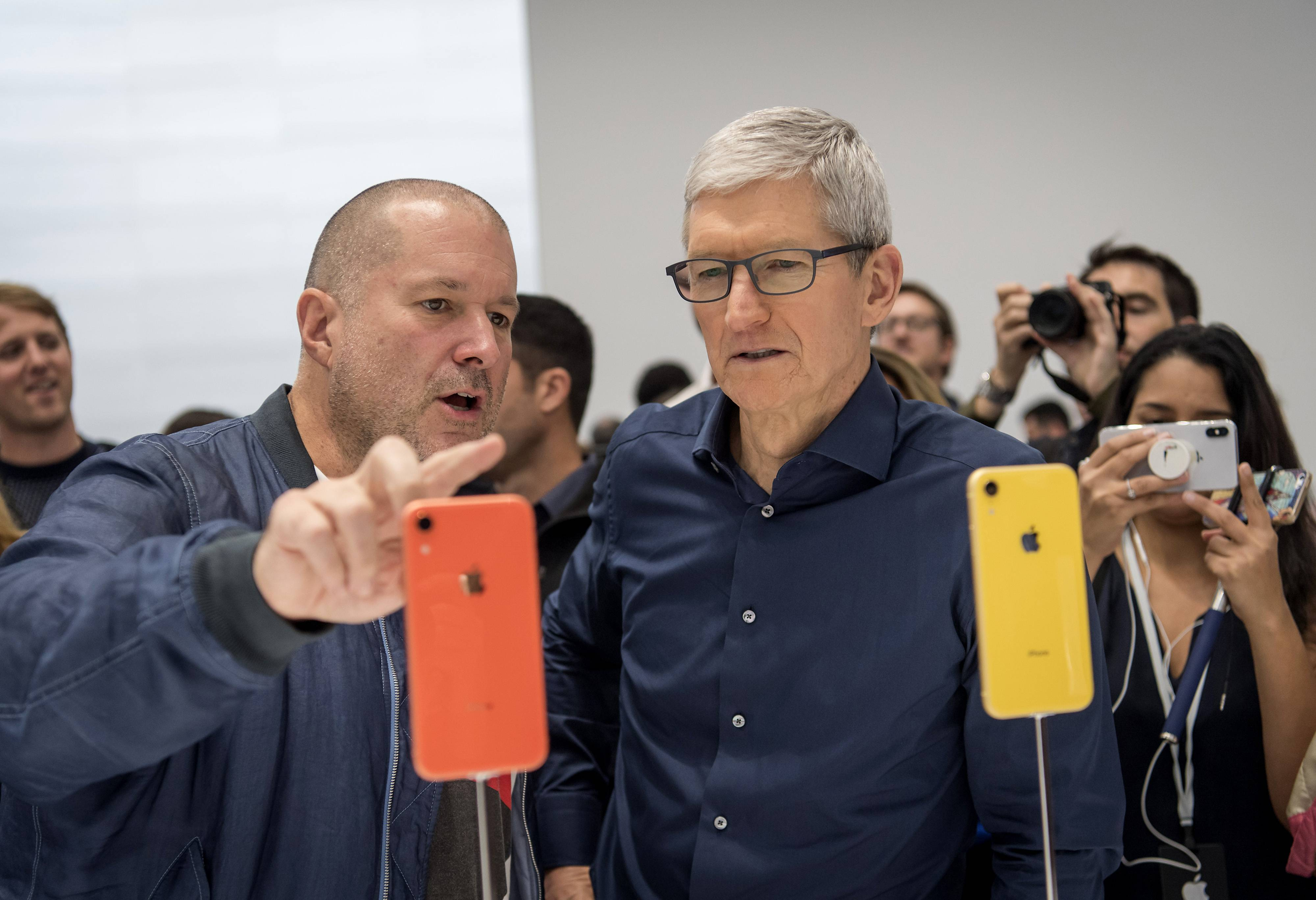 Apple CEO Tim Cook, right, urged consumers in a recent interview not to believe the dominant tech industry narrative that the data collected about them will lead to better services.