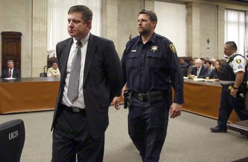 chicago police officer jason van dyke left is taken into custody after jurors found