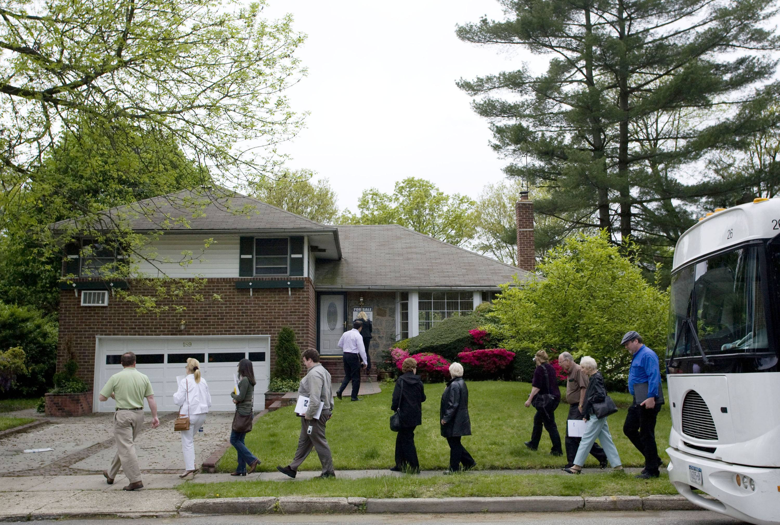 Potential homebuyers visit a foreclosed house in Long Island, N.Y., in May 2008.