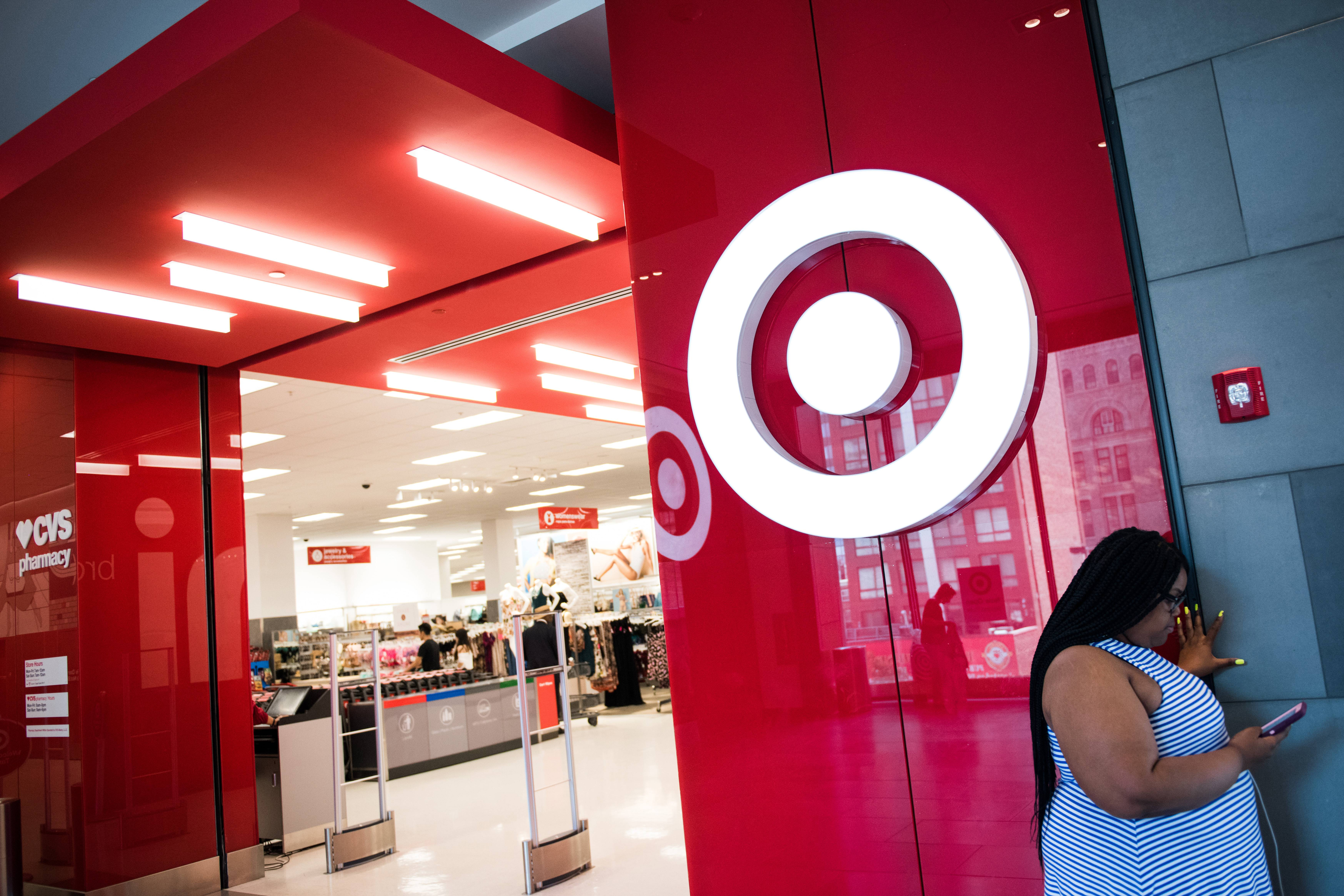A woman checks her phone outside a Target store in New York on July 18, 2017.