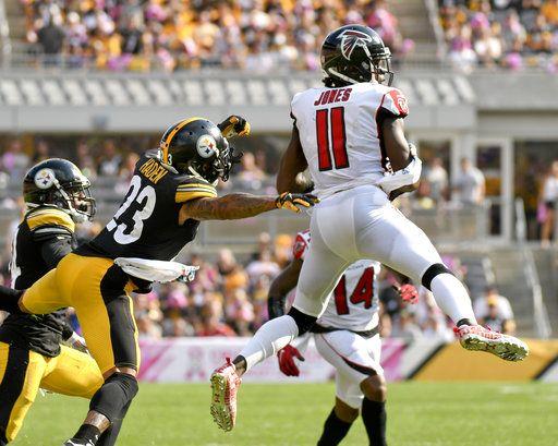 f96de04360c Atlanta Falcons wide receiver Julio Jones (11) makes a catch past  Pittsburgh Steelers cornerback