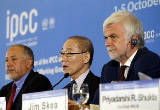 Intergovernmental Panel on Climate Change, IPCC, Chair Hoesung Lee, center, speaks during a press conference in Incheon, South Korea, Monday, Oct. 8, 2018. Preventing an extra single degree of heat could make a life-or-death difference in the next few decades for multitudes of people and ecosystems on this fast-warming planet, an international panel of scientists reported Sunday. But they provide little hope the world will rise to the challenge.
