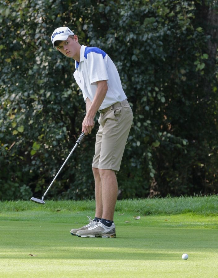 Mark O'Connell of Wheaton North putts on the 11th green at South Elgin boys golf sectional in Bartlett on Monday.