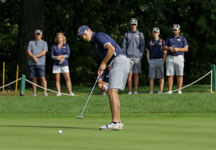 Colin Chromy of Neuqua Valley putts on the first green at South Elgin boys golf sectional in Bartlett on Monday.