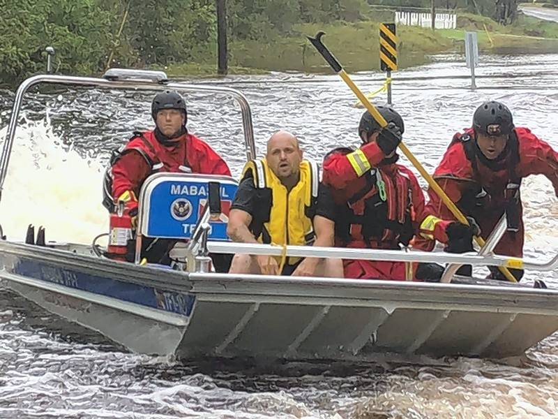 Members of an Illinois search and rescue team help a North Carolina resident who had been stranded by floodwaters after Hurricane Florence. The Wheeling-based team spent more than a week in the disaster area.