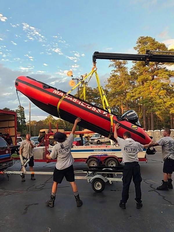 Firefighters with a Wheeling-based search and rescue team get a boat ready in North Carolina after Hurricane Florence.