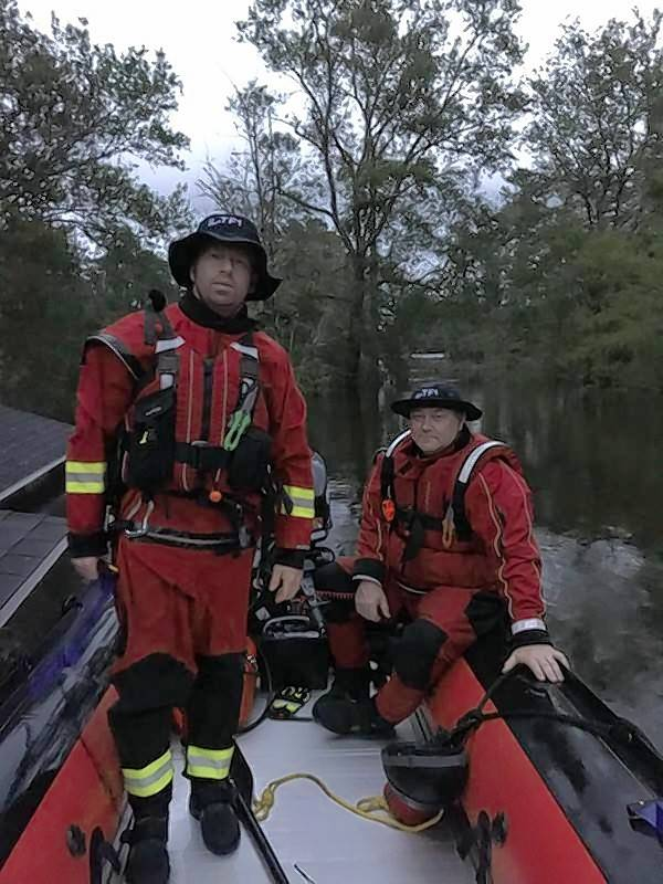 Firefighters Jason Kummelehne, left, and Mike Young conduct search and rescue operations in North Carolina as part of a Hurricane Florence relief effort. They're members of an Illinois rescue team that responded to the disaster.