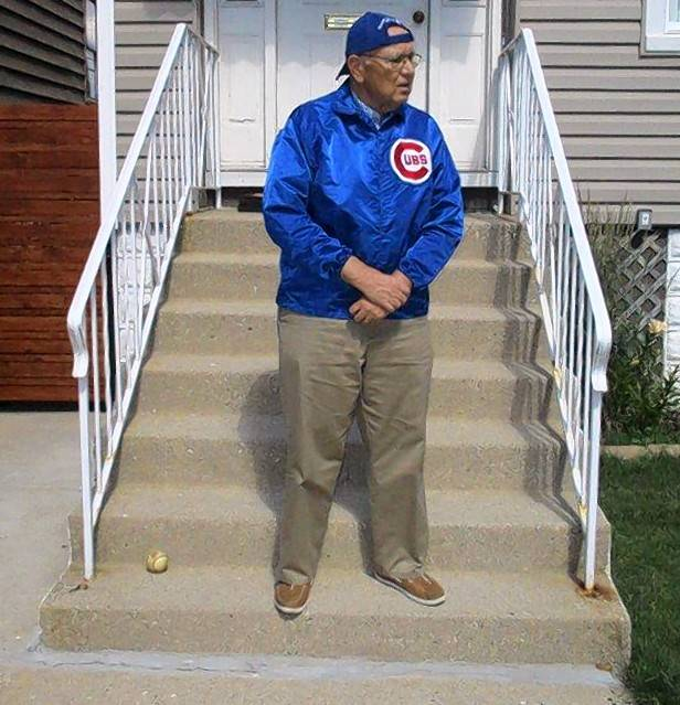 Recalling a photograph taken when he was a 4-year-old Cubs fan in 1949, Tom Henningsen of Wheeling strikes the same pose on the same porch during the Cubs' 2016 World Series championship season.