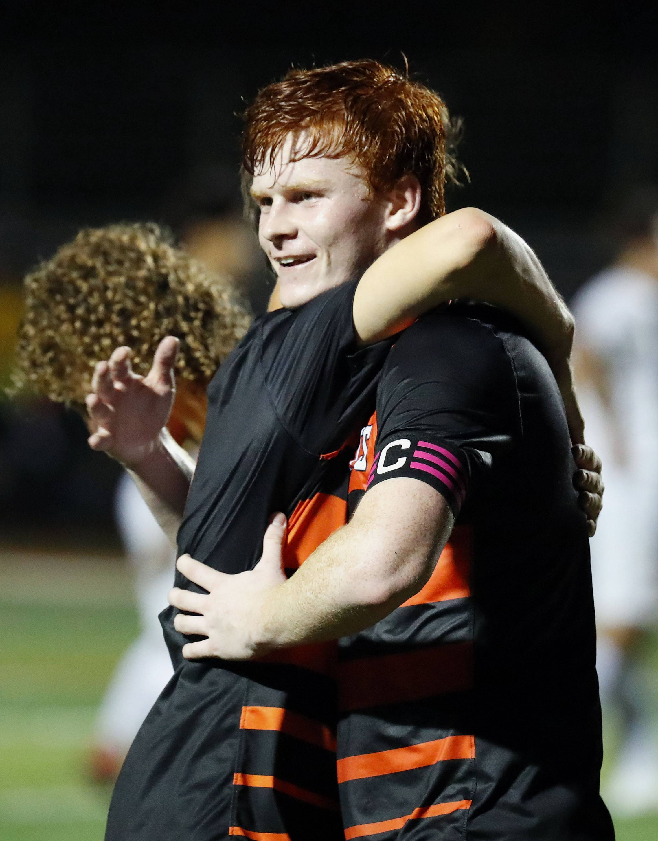 Libertyville's Evan Rasmussen gets a hug after scoring his 50th career goal during their game Tuesday night in Libertyville.