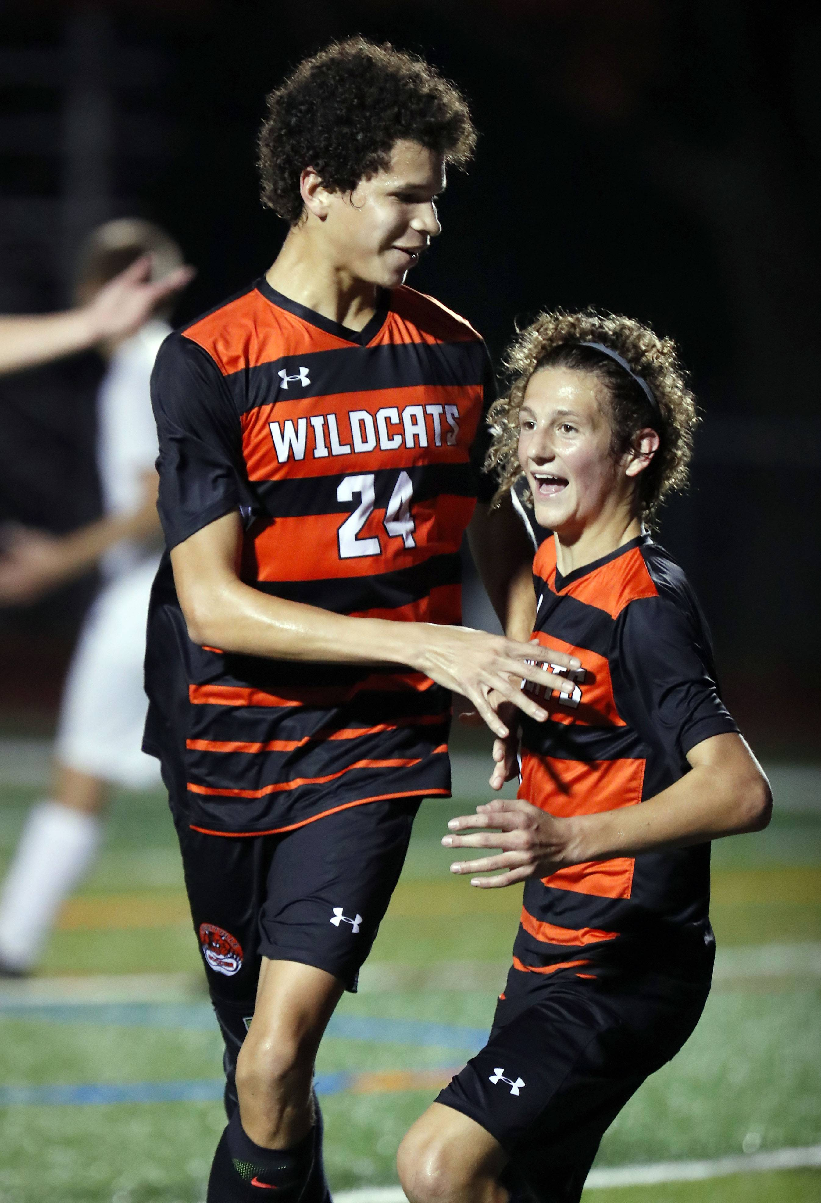 Libertyville's Mickey Reilly, right, celebrates with Mason Williams after Williams' goal during their game against Lake Forest Academy Tuesday night in Libertyville.