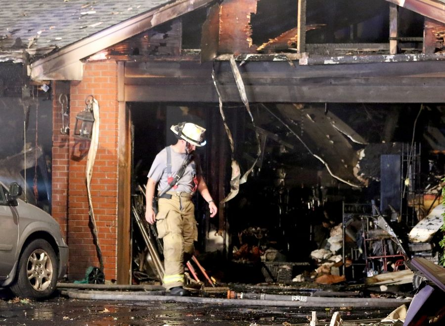Elk Grove Village firefighters on Wednesday night work on the scene after a fire heavily damaged a house on Crest Avenue near Ridge Avenue and Landmeier Road.