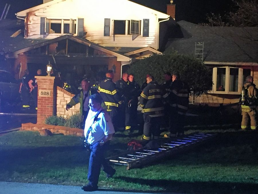 Firefighters continue to work on putting out a blaze in a house Wednesday on the 500 block of Crest Avenue in Elk Grove Village.