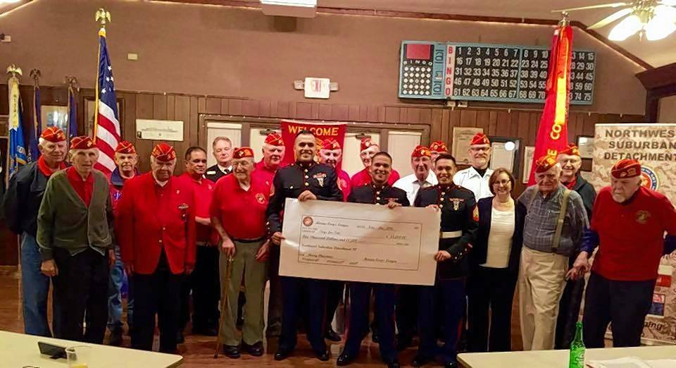 Members of the Northwest Suburban Marine Corps League Detachment 80 gather in October 2017 with members of the U.S. Marine Corps Reserve 2nd Battalion 24th Marines based in Chicago to deliver fundraising proceeds of $5,000 for Toys for Tots.