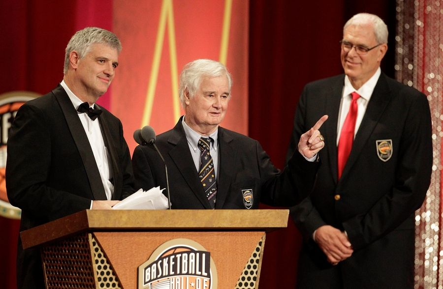 Tex Winter, center, gestures as his son, Chris Winter, left, delivers the address for his father at his Basketball Hall of Fame enshrinement ceremony in Springfield, Mass., Friday, Aug. 12, 2011. At right is Phil Jackson.