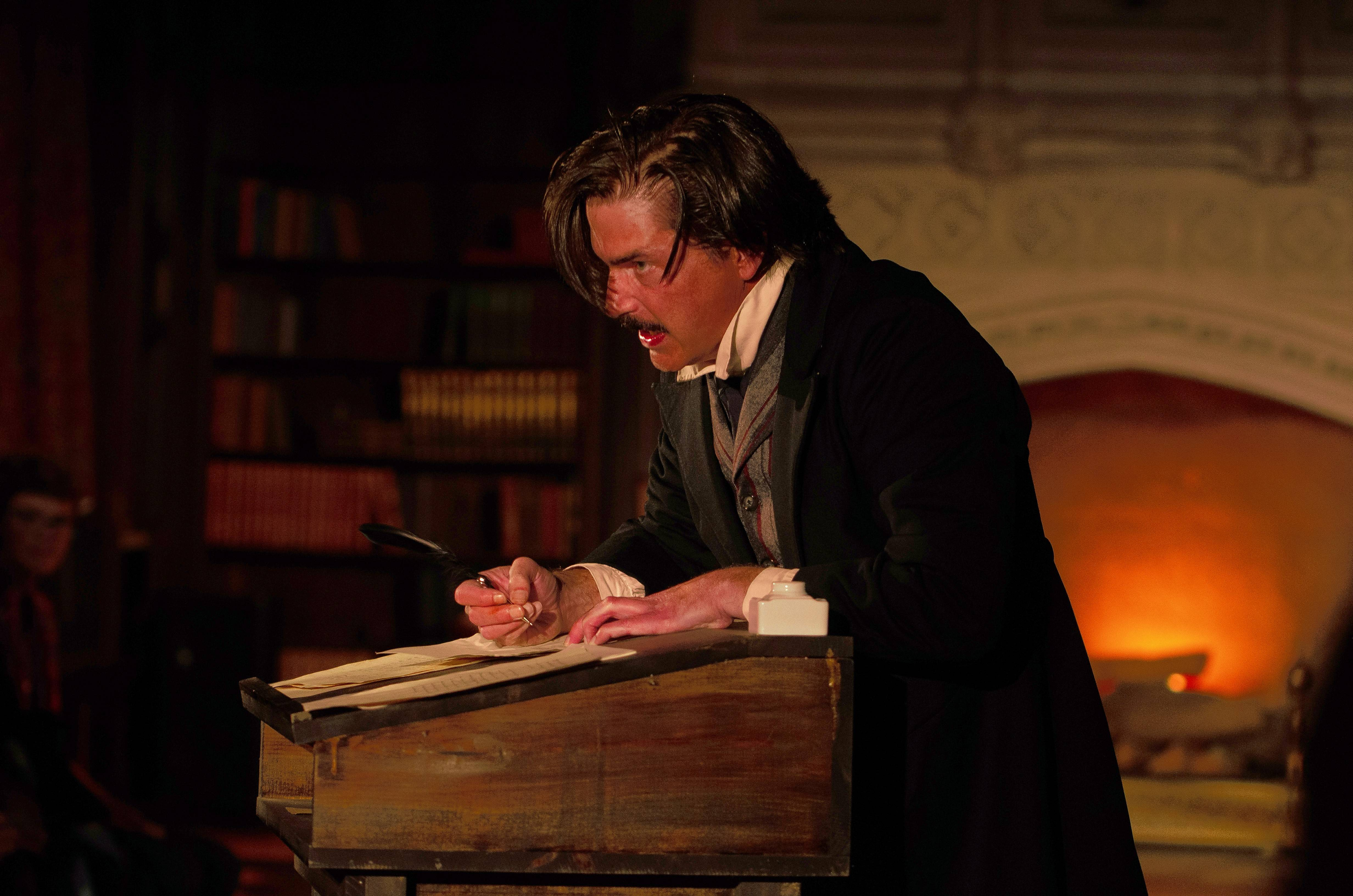 "Ensemble member Christian Gray plays Edgar Allan Poe, whose macabre tales reflect his tormented soul in First Folio Theatre's ""The Madness of Edgar Allan Poe: A Love Story."""