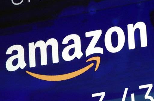 After backlash, Amazon to boost pay for longtime workers