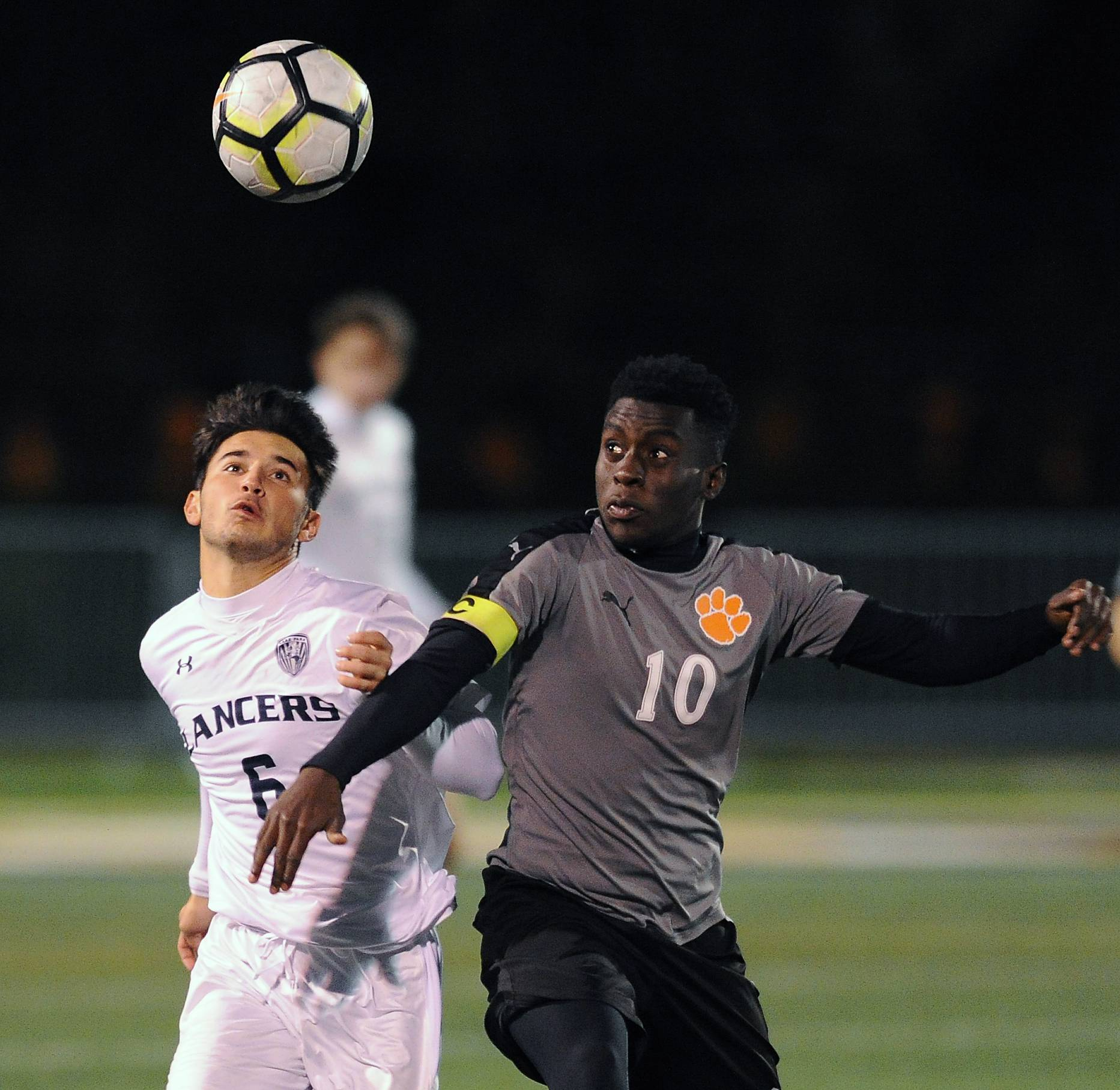 Lake Park's Andrew Eliopoulos battles with Wheaton Warrenville South's Sumani Husseini in the first period of play at Wheaton Warrenville South High School on Thursday.