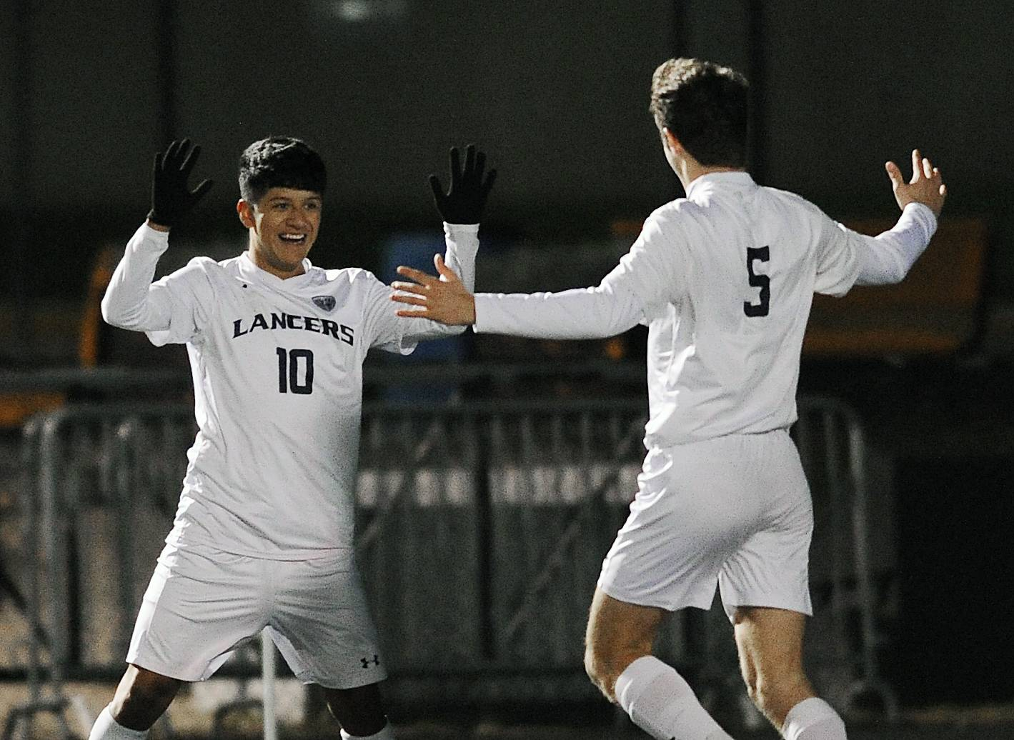 Lake Park's Jesus Juarez (left) celebrates his first period goal with teammate Thomas Zakic at Wheaton Warrenville South High School on Thursday.