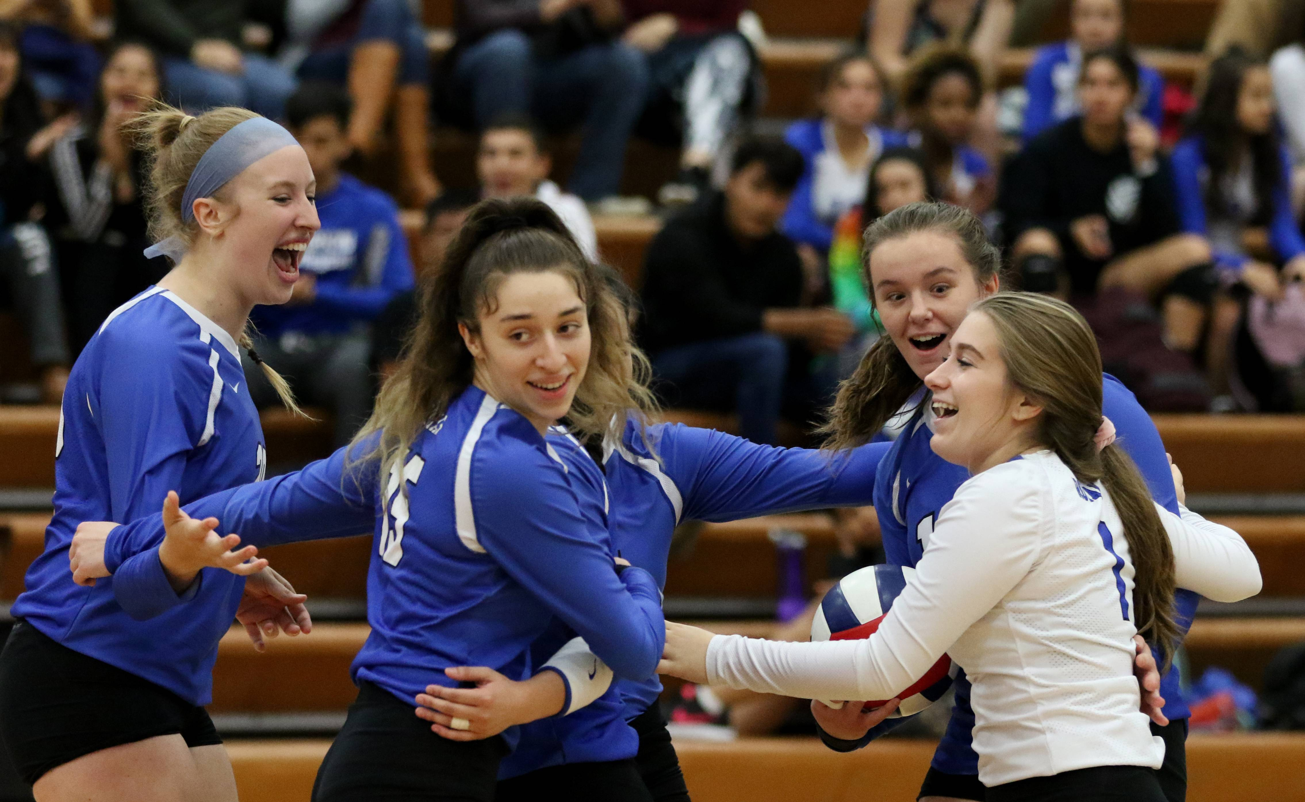 Larkin players get together after a point against Elgin in varsity girls volleyball at Larkin on Wednesday.